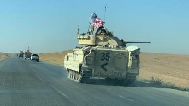Photo of قوات أمريكية على متن عربات مدرعة ودبابات أبرامز